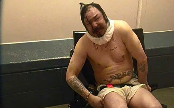 Christopher Lopez, 35, sits restrained with a spit hood over his head in the final hours of his life. (Provided by the Colorado Department of Corrections via a lawsuit by the estate of Christopher Lopez)